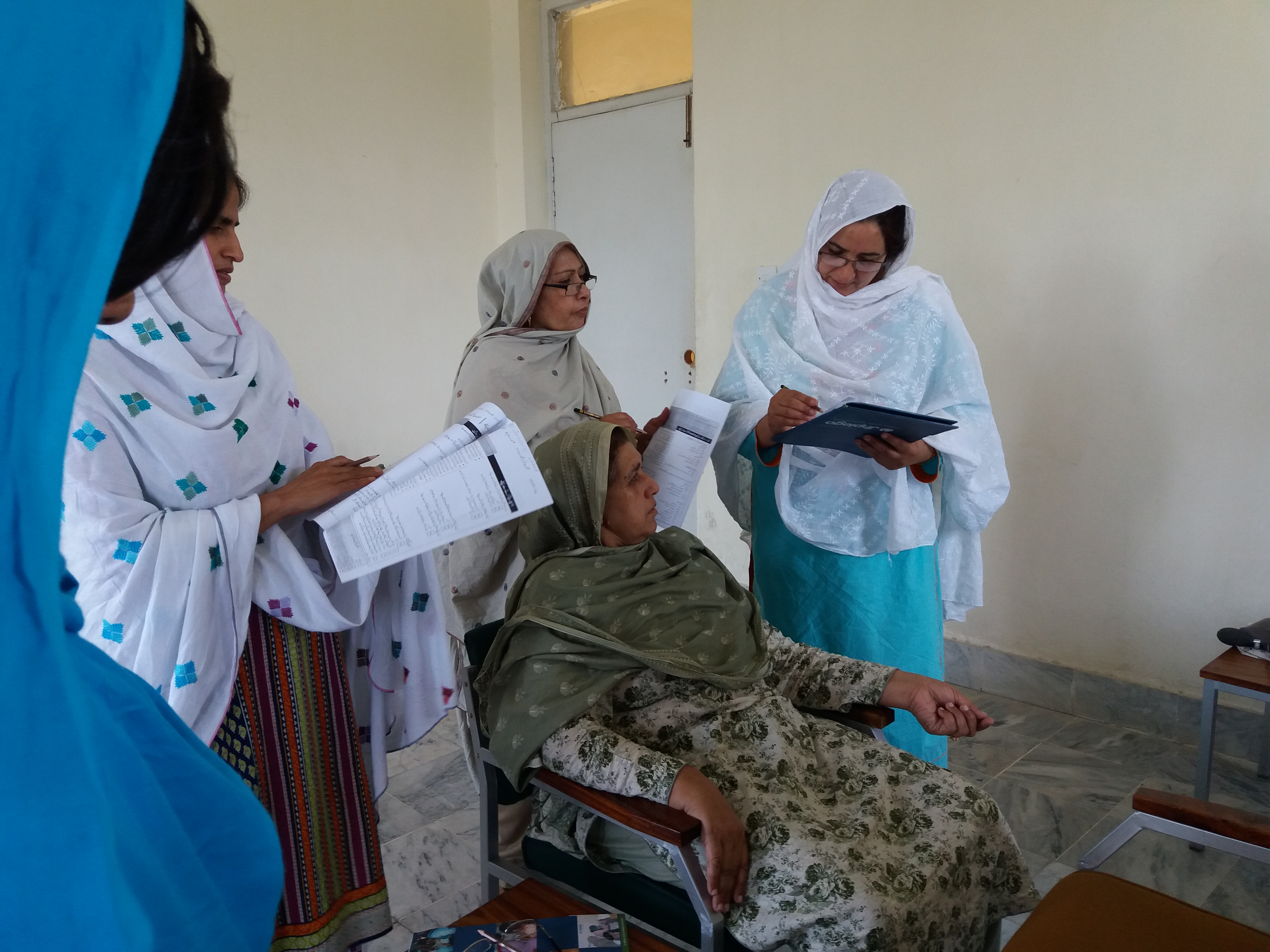 Lady Health Visitors and Community Midwives engaged in interactive role plays to facilitate learning during the Safe Childbirth Checklist training in the province of Khyber Pakhtunkhwa, Pakistan