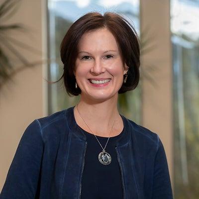 Portrait of Assoc. Prof. Joyce Edmonds (CSON) photographed in the nursing offices of Maloney Hall.