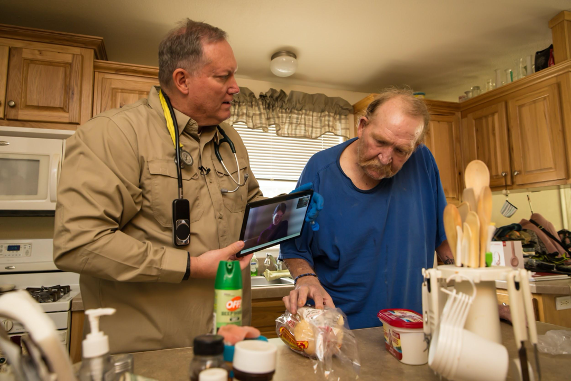 Paramedic Steve Holley reviews nutritional labels with a patient during a mock home hospital admission.