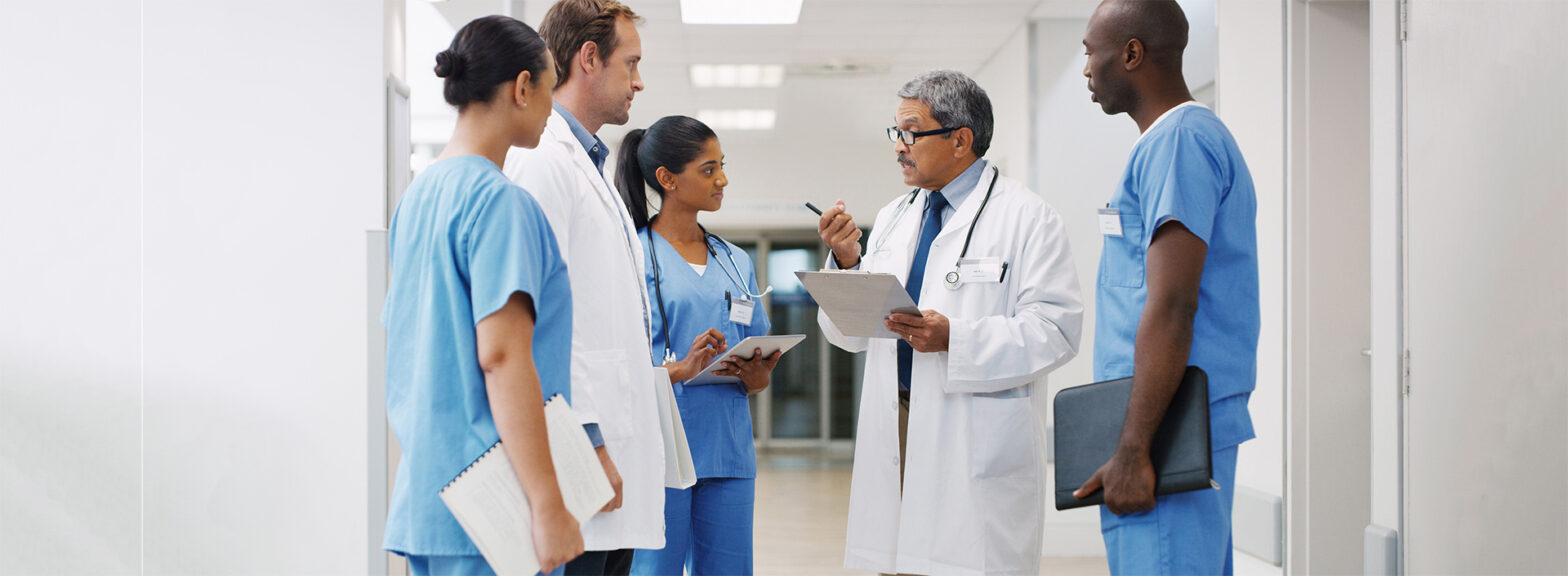 A group of medical practitioners having a discussion in a hospital